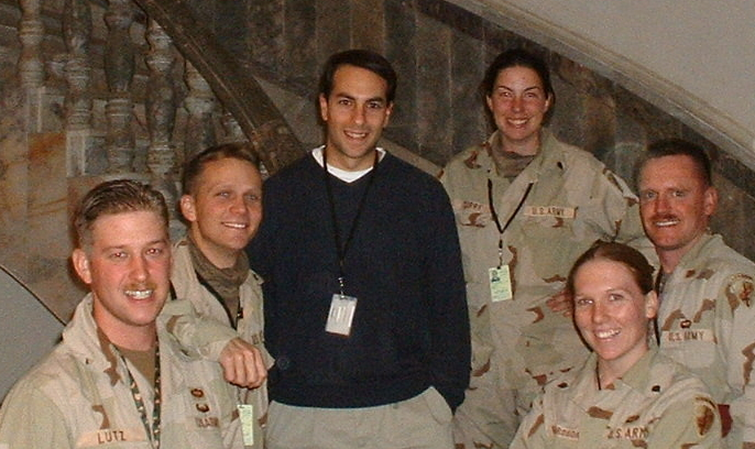 Tom meets with active duty service members in Baghdad, Iraq.