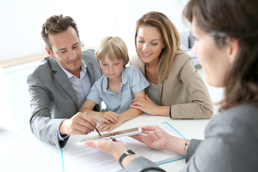 family-signing-loan-papers.jpg