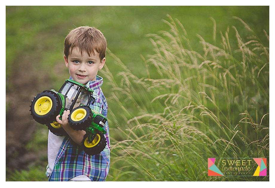 a boy and his John Deer tractors