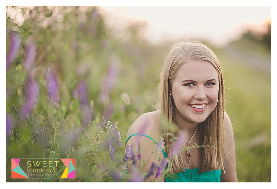 Senior girl photographed in green dress purple flowers