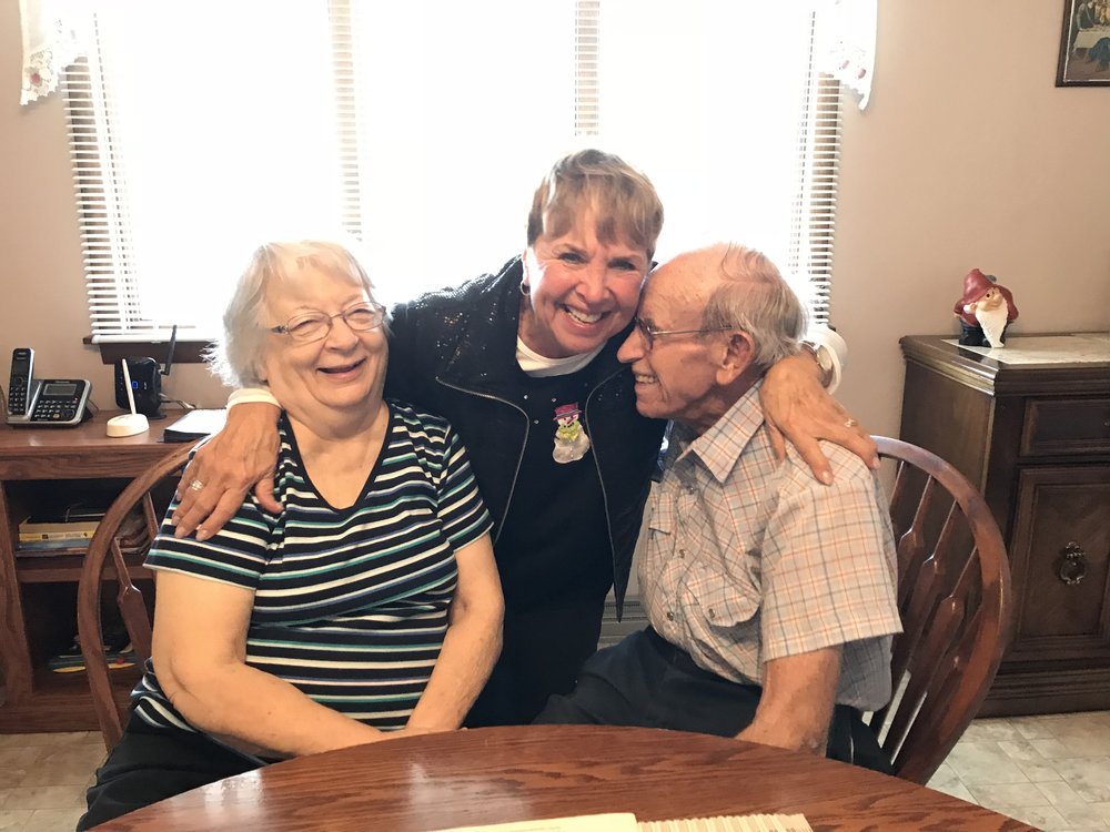 My mom enjoying a laugh with our 'old' neighbors.