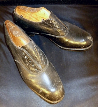Shoes made by a local cobbler, Mr Griffiths, for his daughter. She died at the age of 13 from Diphtheria. This was the last pair of shoes Mr Griffiths made. -