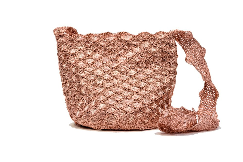 """A Jewel of the Sea"": the newest Mochila Verdi is a hand-woven rose-gold edition, inspired by Colombia's beaches. Photo courtesy of  Verdi Design."