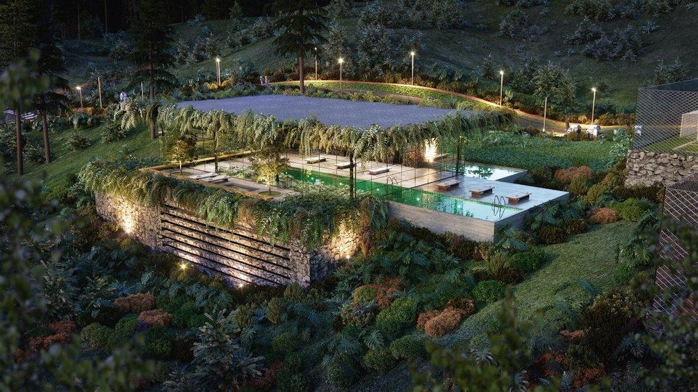 Otra perspectiva de la piscina, rodeada por una reserva ambiental natural.