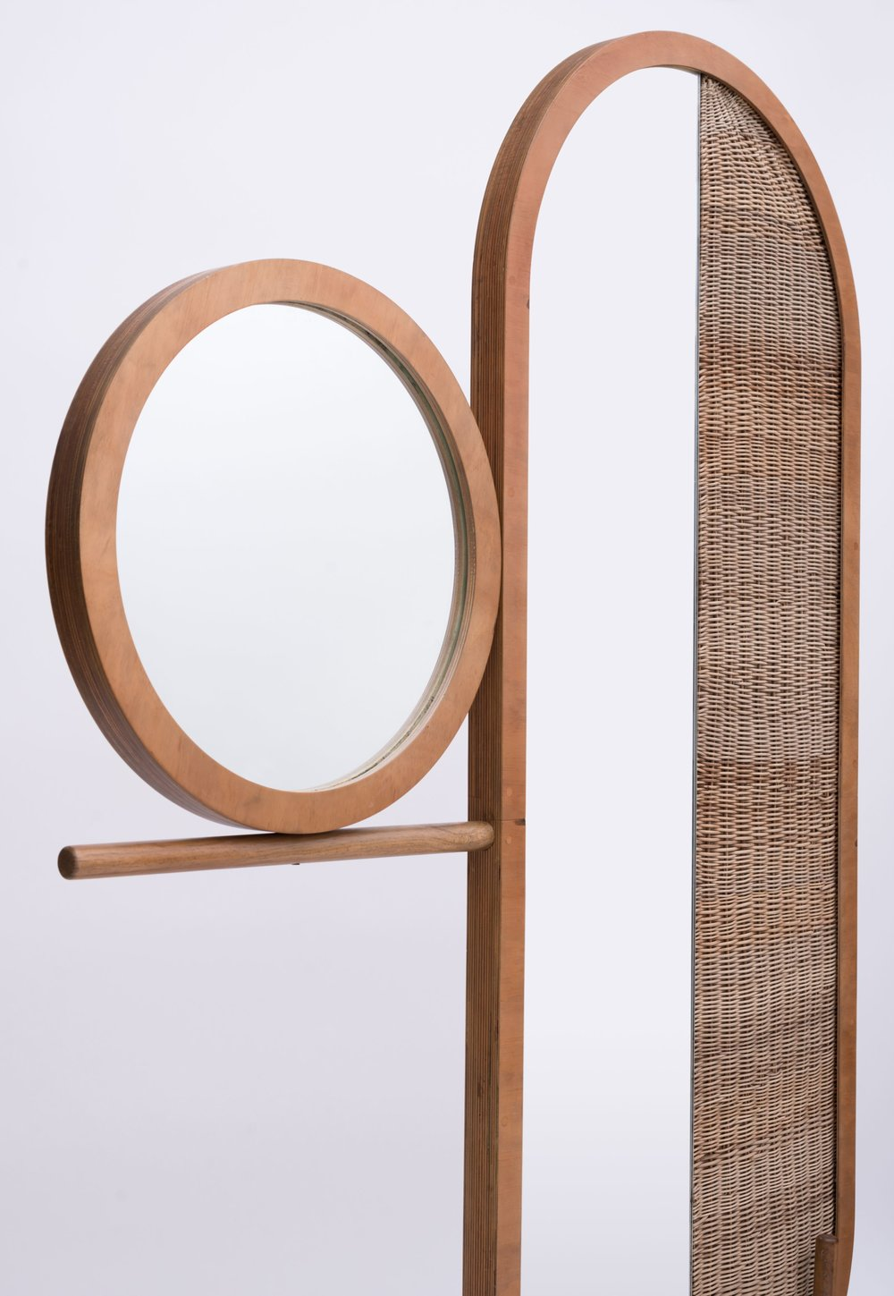 Eclipse/ Sol Screen - An homage to the solar eclipse, this set of screens plays with the duality of solid and empty space, combining circular shapes halved by a hand woven wicker weave. Made with hand-woven wicker, mirror, and pine.