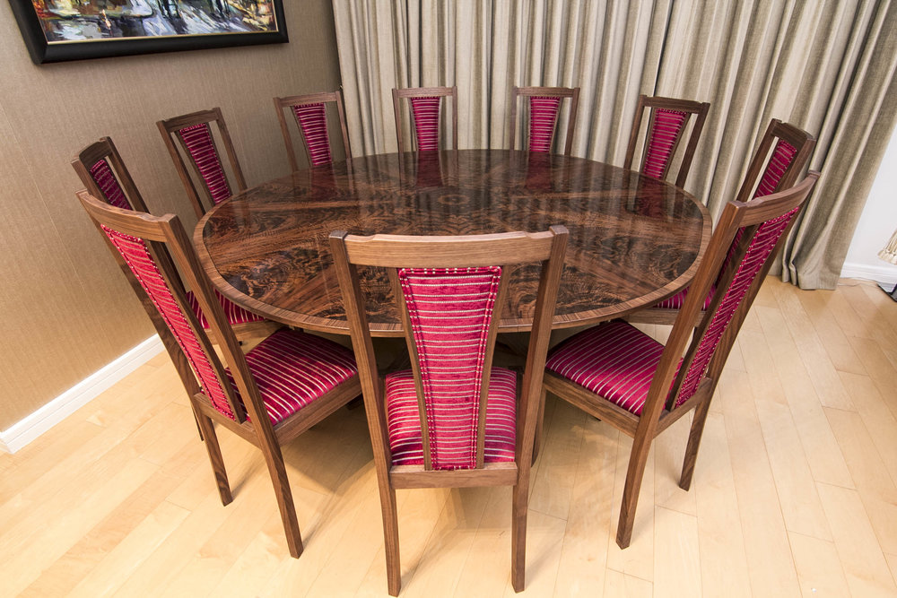 Expanding circualr dining table and 10 chairs in walnut