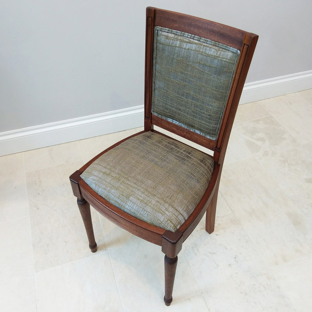 Upholstered sapele dining chair