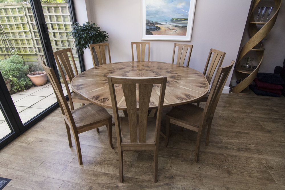 Exapnding dining table with oak chairs
