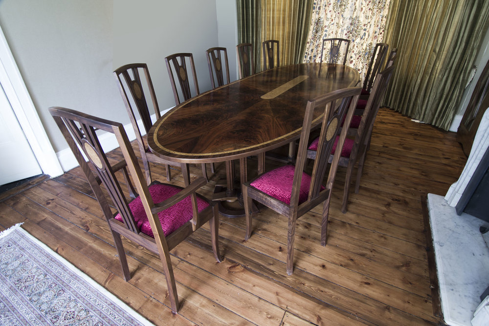 Copy of oval extending dining table in walnut with chairs