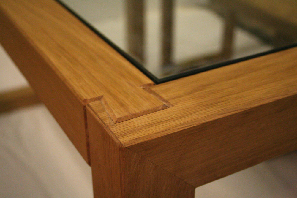 Oak and glass dining table dovetail detail