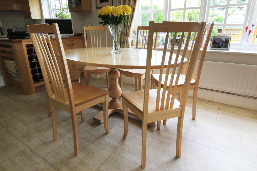 Dining table and chairs in maple