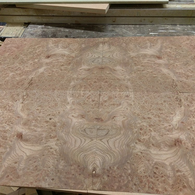 Quarter matching four pieces of veneer