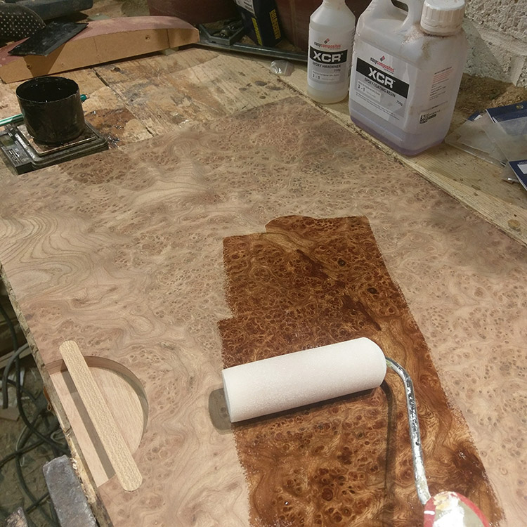 Applying an epoxy resin grain filler