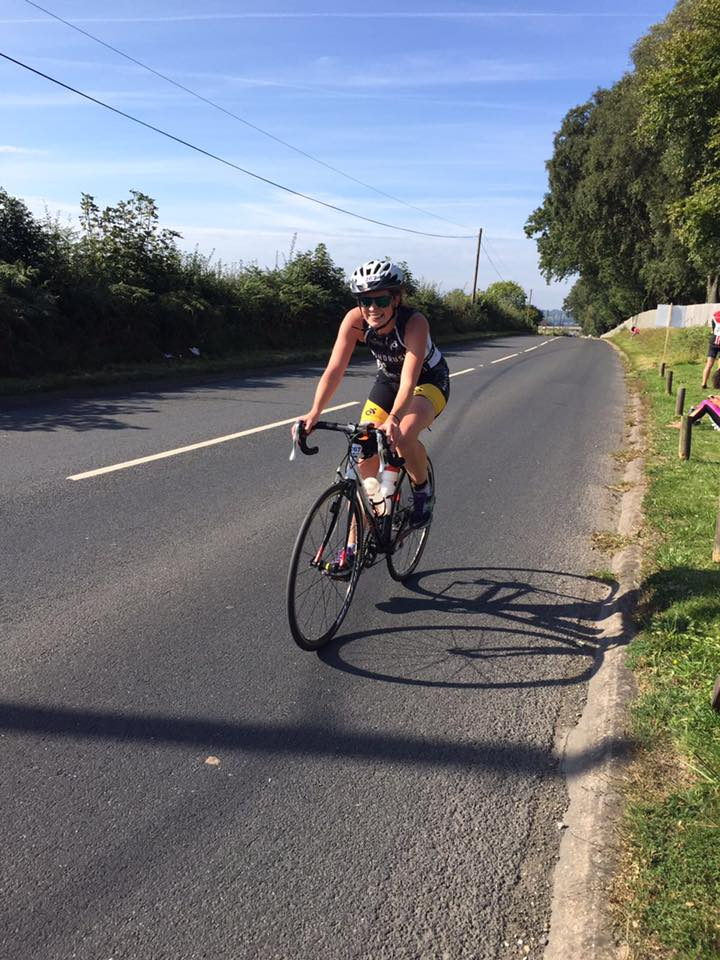 Female Windrush triathlon cycling on road