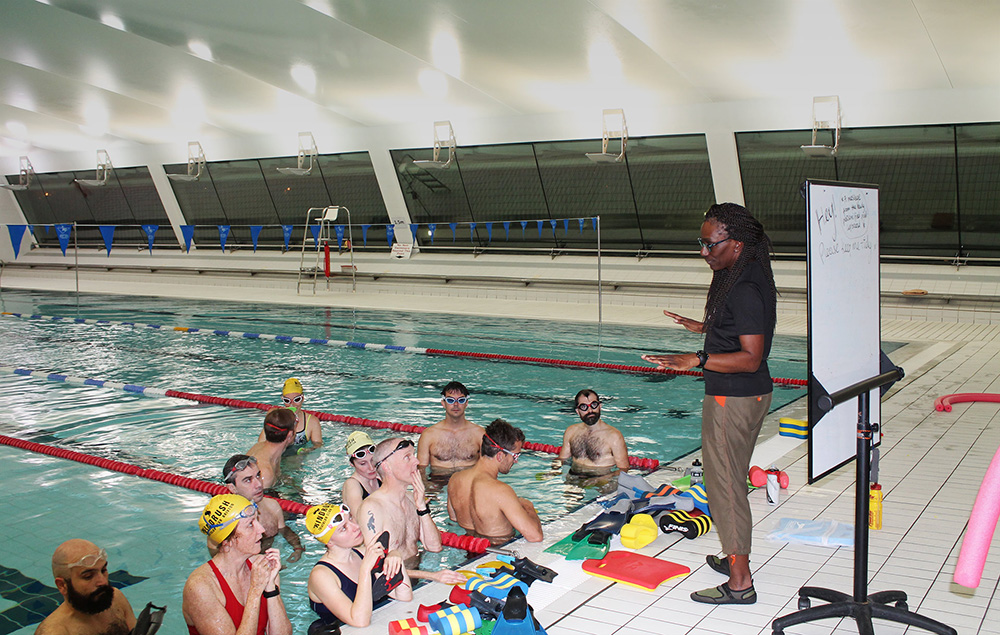 Windrush coach Audrey coaching swim course at indoor pool