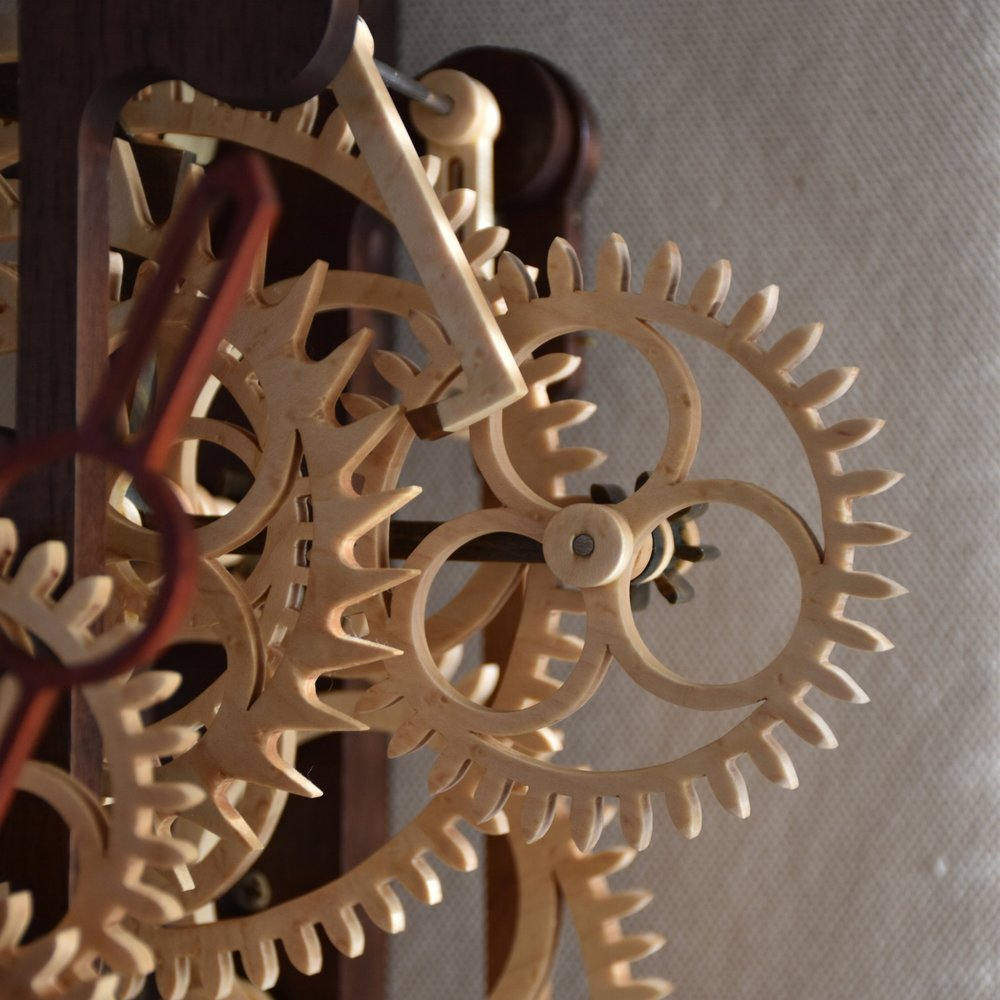 My Inspiration - I've always been inspired by artisans and their pursuit of excellence in their craft. As a clockmaker working primarily with wood, I draw inspiration from the past to find interesting techniques or features that I can incorporate into new designs. The challenge is to combine them in new and artistic ways, while at the same time, achieve accuracy and precision within a medium that is inherently not stable.I feel that being able to work with your hands is a gift, and I continually strive to improve those skills as I develop a piece. This is my own pursuit of that excellence in craftsmanship.