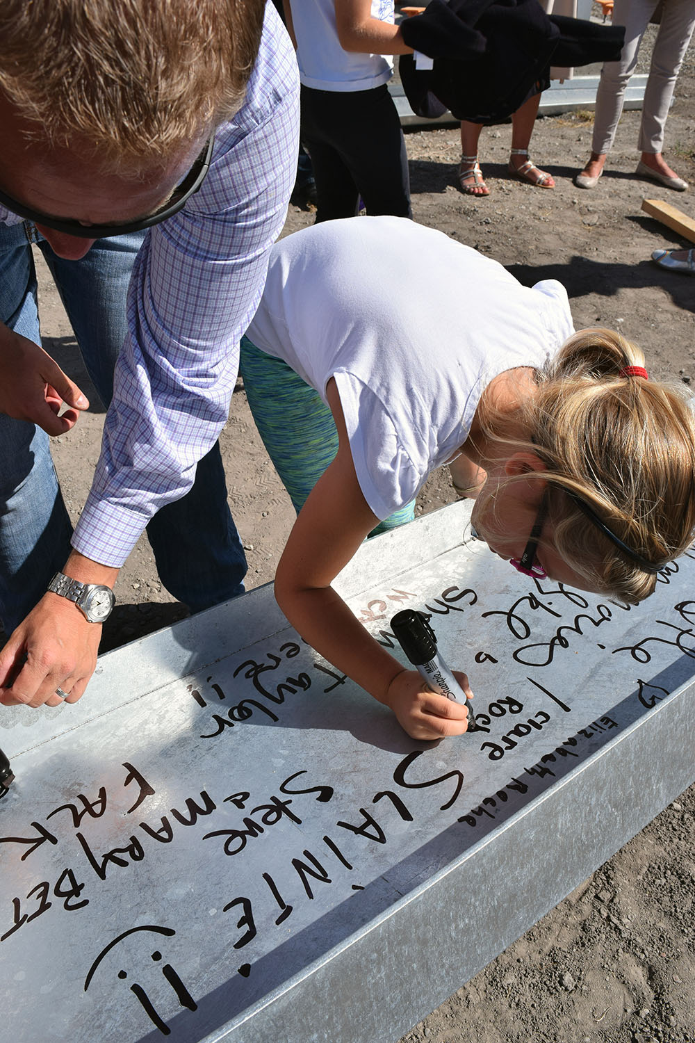 Clare Roche, daughter of Brendan & Colleen Roche, leaving her name on the beam