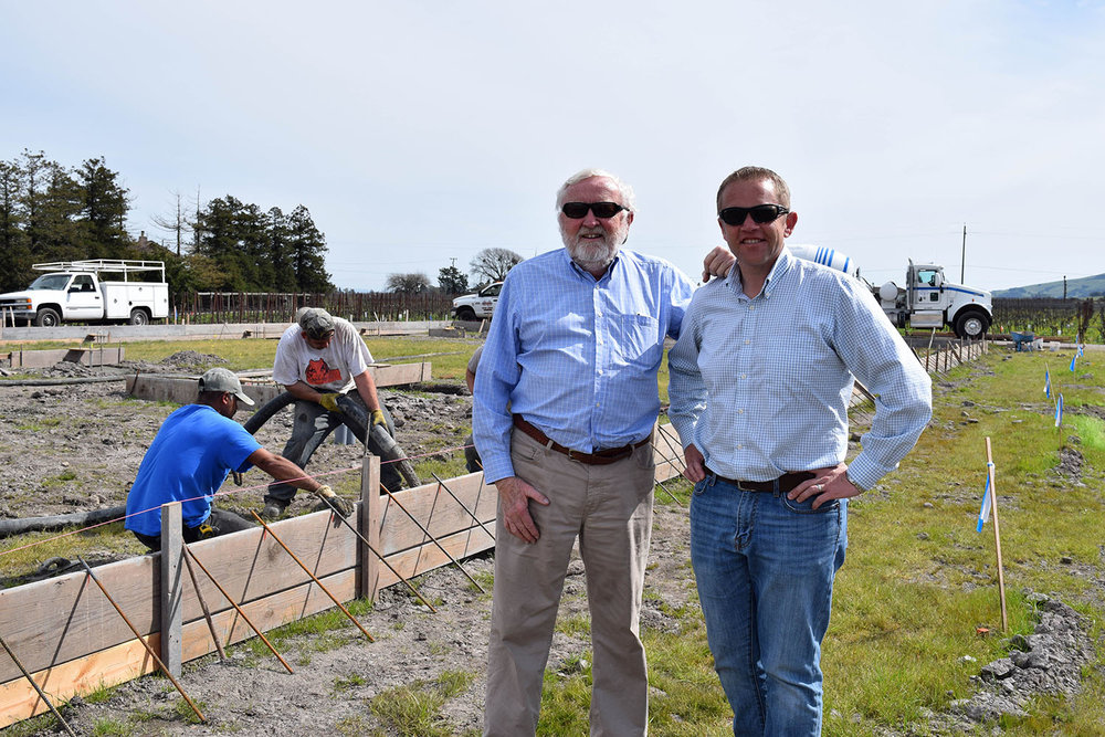 Joseph and Brendan Roche pleased to finally see the footings being poured after 3 years of planning
