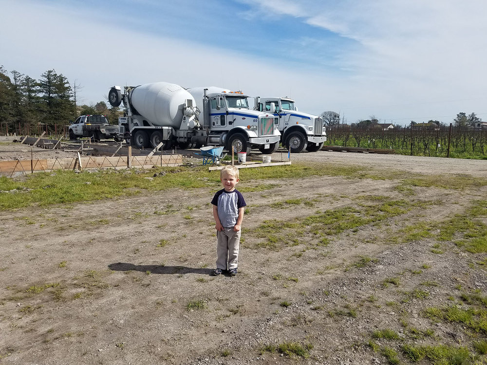 Liam Roche, son of Brendan & Colleen Roche, is more excited about the big concrete trucks then the actual concrete being poured