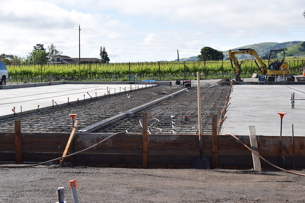 Awaiting the third pour of the barrel room building