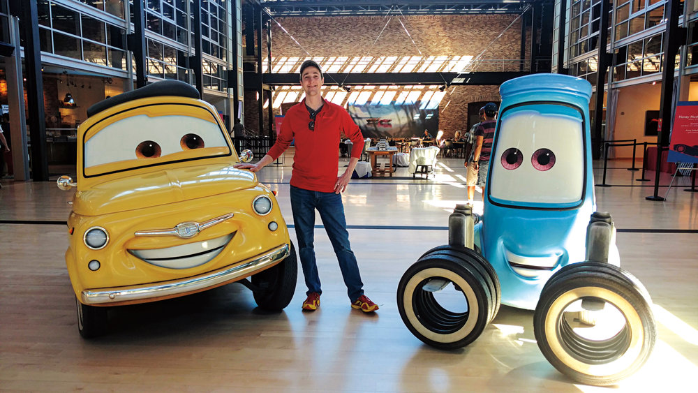 Curtis with movie characters Luigi (l.) and Guido after finishing layout on the Disney/Pixar animated film  Cars 3 .