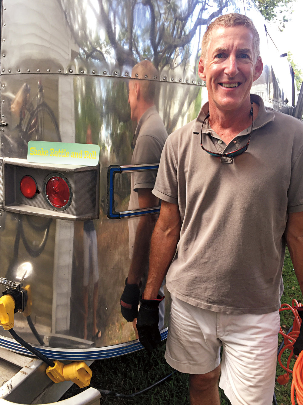 "Bryan Bell '78 posing with ""Shake, Rattle and Roll"" – the airstream camper of Bruce Seabrook '78, named in honor of Bill Abbé."