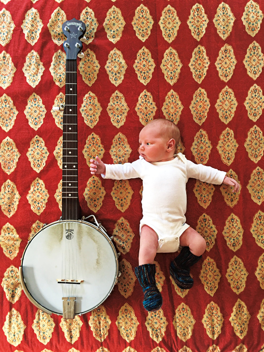 August Brewster Rauch, son of Ned P. Rauch '94, alongside Ned's banjo (for scale).