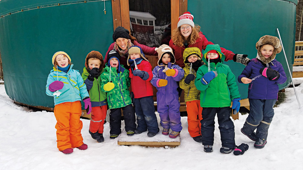 Kindergarten students and their teachers, including Anne Stires '94, in front of the yurt that functions as their indoor classroom.