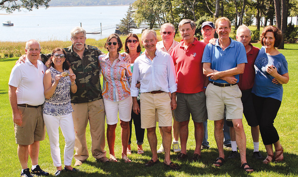 (L. to r.) Fritz Newman '70, Dolores Newman, Guy Nouri '70, Laurie Host, Pat Crandall, George Host '70, Steve Crandall '70, Tres Davidson '70, Chris Bartle '70, Brooke Roberts '70, Don Lippincott '70, and Laraine Lippincott met in Buzzards Bay.