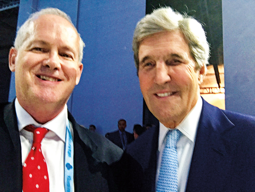 Jim Brooke '73 (l.) and John Kerry '62 stopped for an SPS photo op following a dinner in Kyiv in September.