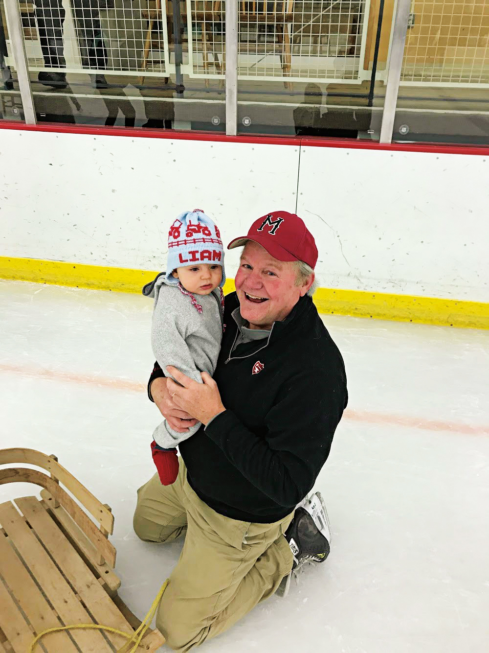 John Marchand '75 and grandson Liam on the Middlesex School rink.