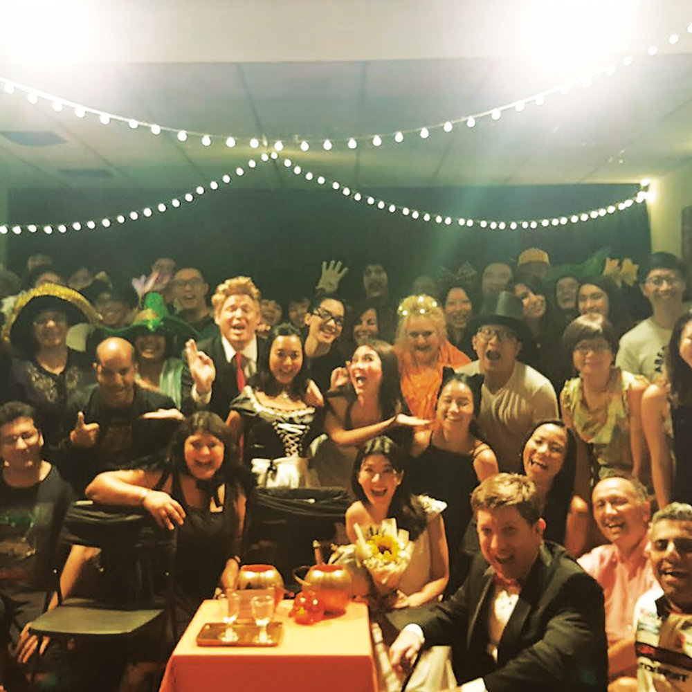 Chris Holland '92 with the audience at a performance of his hour-long comedy  Halloween Date .