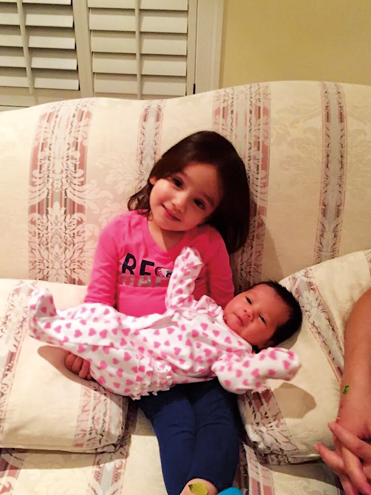 Caroline Willard holding Emeline, daughters of Devina Luhur Willard '03 and husband Dustin.