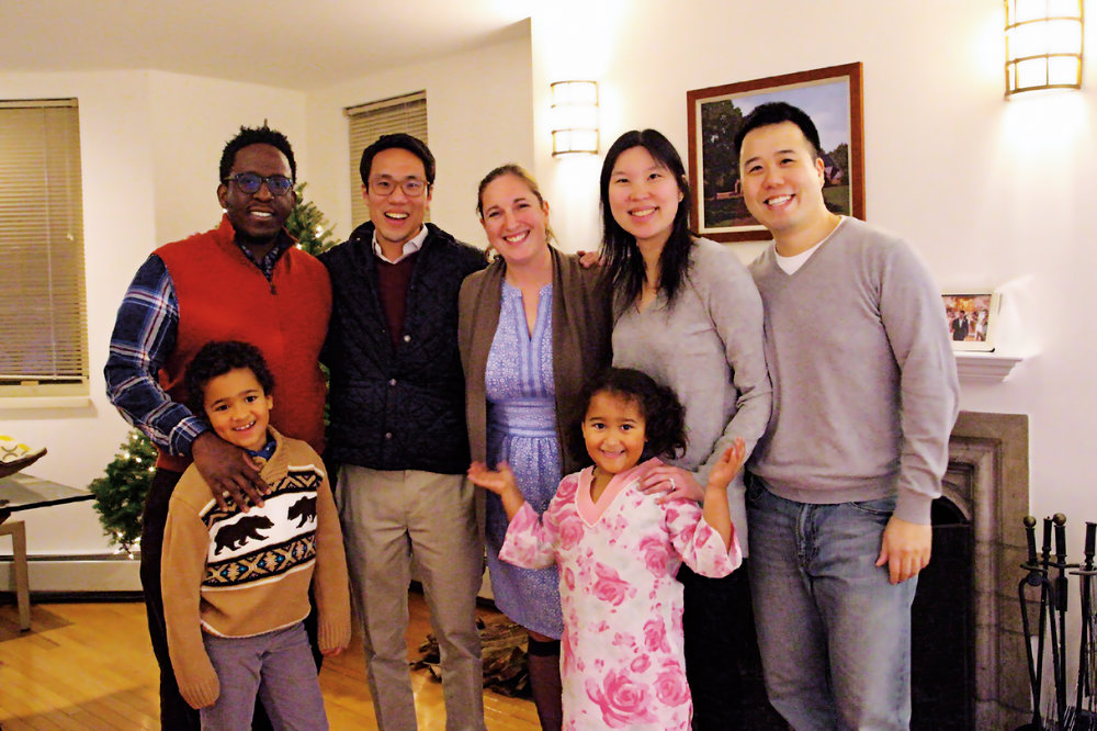 (L. to r.) Shamar Whyte (husband of Michelle Dodge '03), Thomas Ho '03, Michelle, Irene Kim'03 and husband Andrew, along with Michelle and Shamar's son, Langston, and daughter, Tenney, enjoyed a mini-reunion after Lessons and Carols.