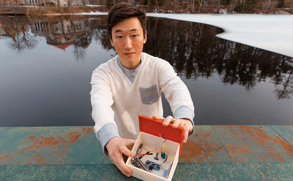 Joon Kim '18 with his water monitoring system.
