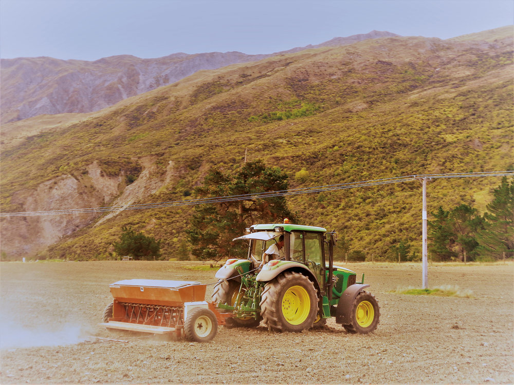 Seeding is one of the many tasks Q Belk '73 and his wife, Sherry, undertake regularly on their farm in New Zealand.