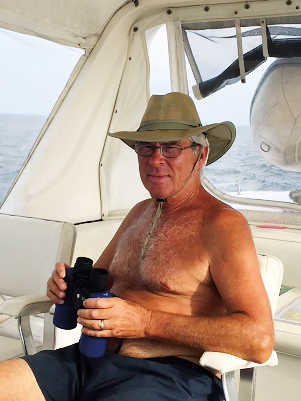 Alex Kulch '73 aboard his 50-foot motor yacht where he lives with his wife, Judy, and cat, Sea-Sea.