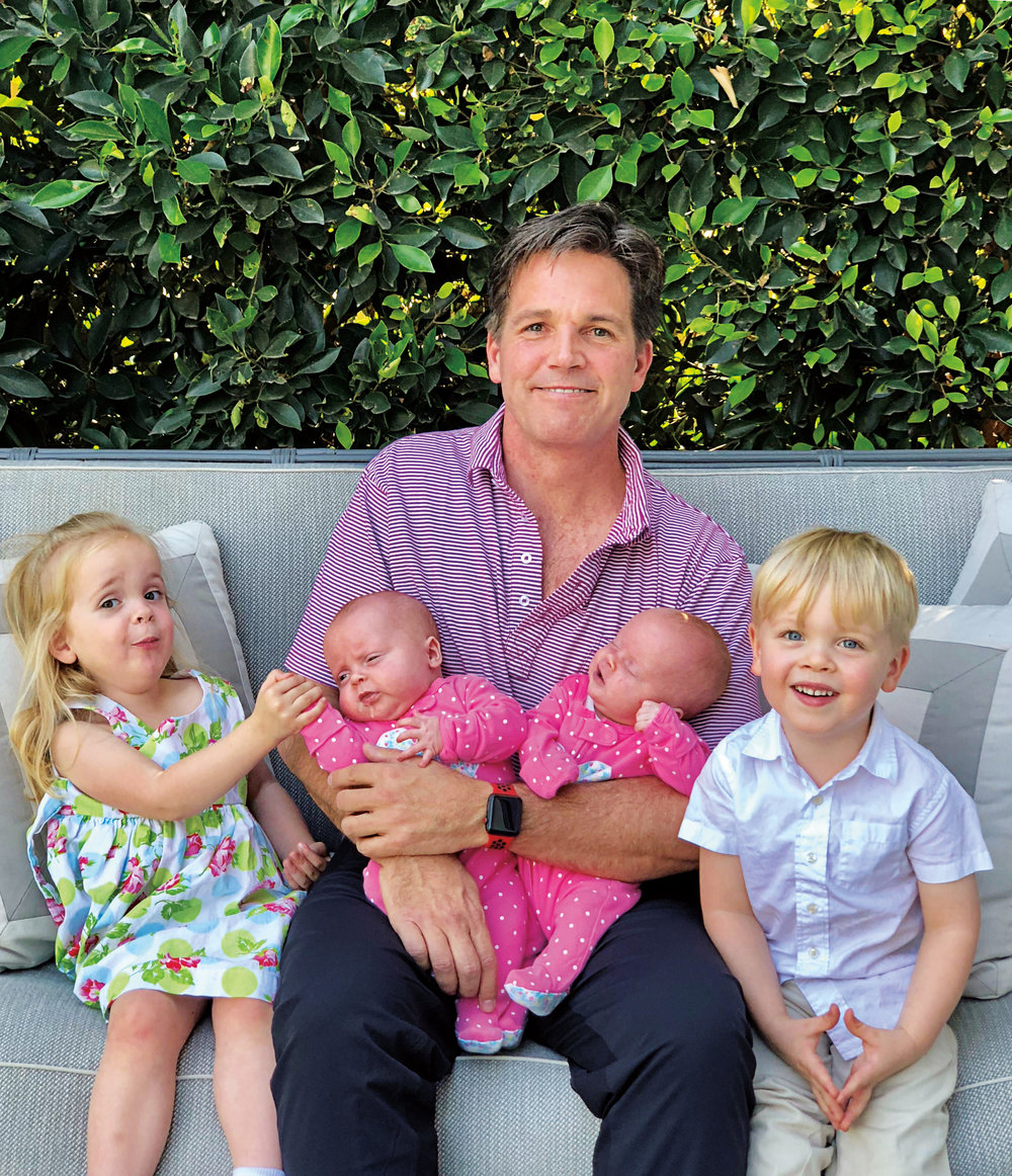 Tom Swan '87 with newborn twins Hope and Grace and three-year-old twins Sam and Rose.
