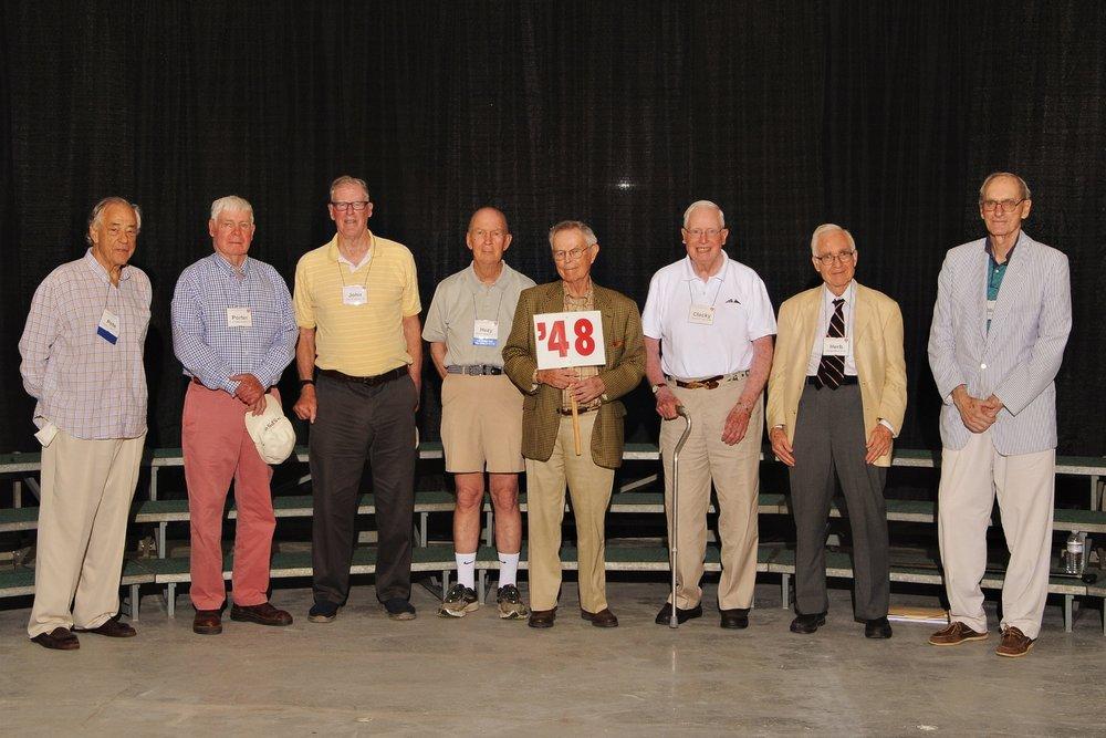 (L. to r.): Pete Coley, Porter Hopkins, John Stinson, Hezy Sprague, Burt Closson, Clacky King, Herb Barry, and Ollie Wolcott.