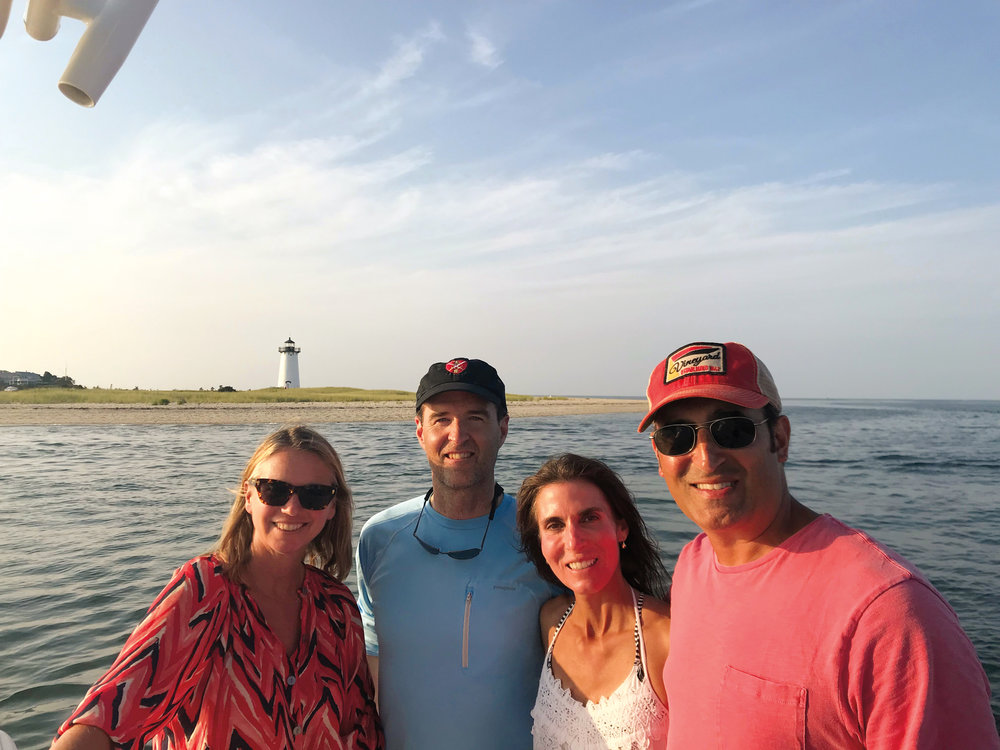 (L. to r.) Megan Murphree (fiancée of Lance Khazei '85), Jim Frates '85, Beth Frates, and Lance in Edgartown, Mass.