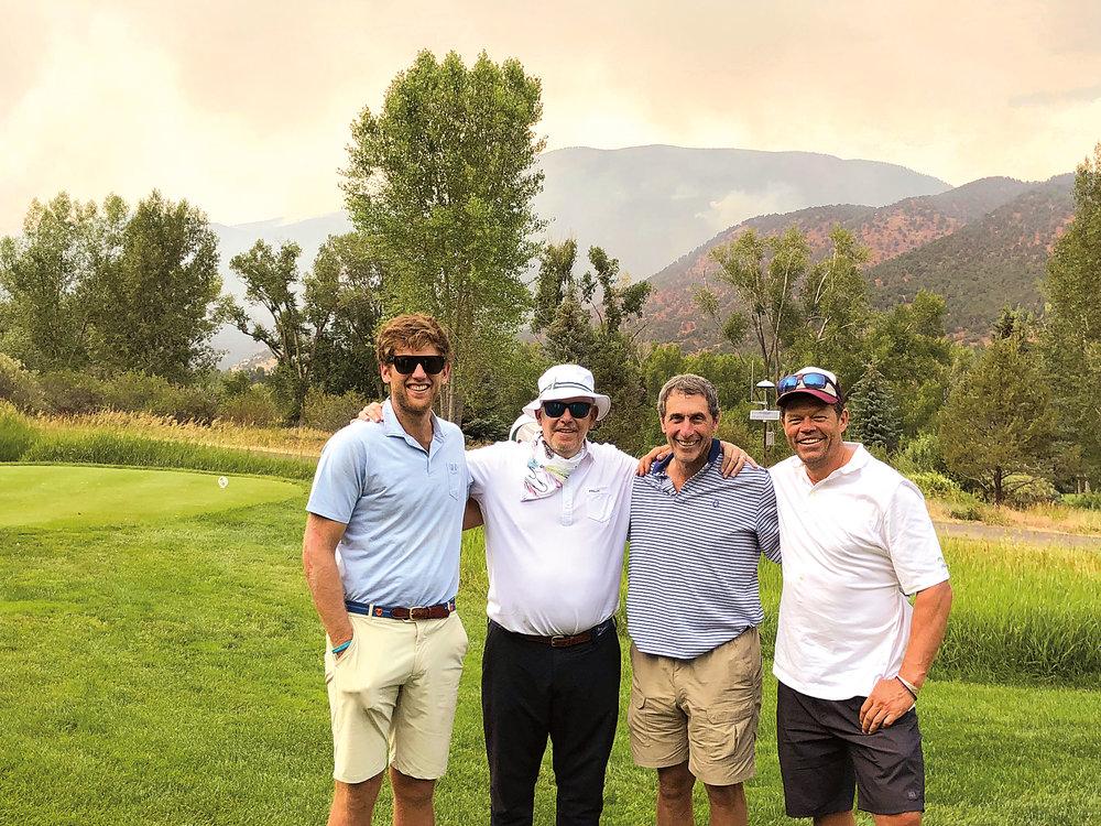 (L. to r.) Jacob Ruttenberg '13, Ernesto Cruz '72, Eric Ruttenberg '74, and Pete McBride '89 golfing in Colorado.