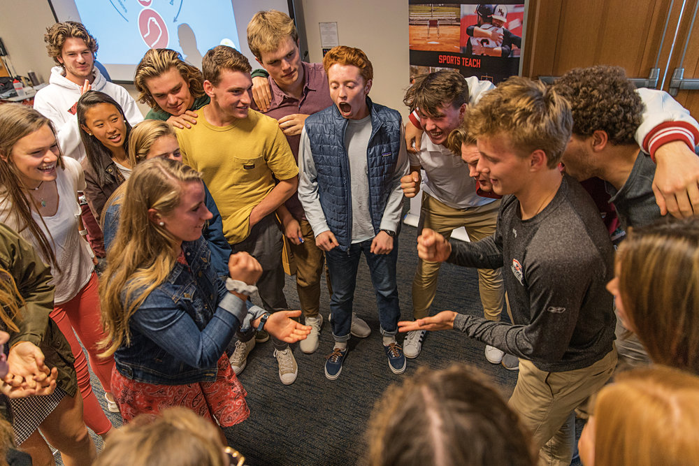 While participating in a Positive Coaching Alliance workshop, student-athletes played rock, paper, scissors to emphasize the focus on team over self.