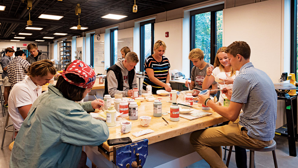 Becky Soderberg '94 (c. in stripes) says her perspective as an art teacher stems from her time as a student at SPS.