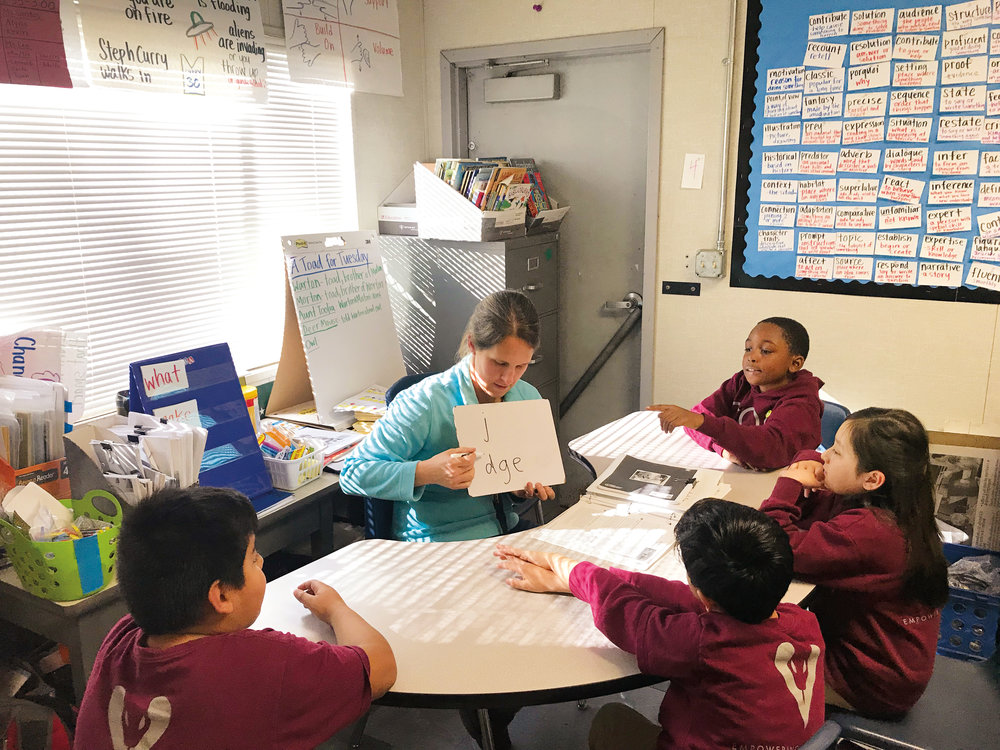 Caitlin Dobson '99 has come to love teaching students from disadvantaged communities because of the relationships formed with students and their families.