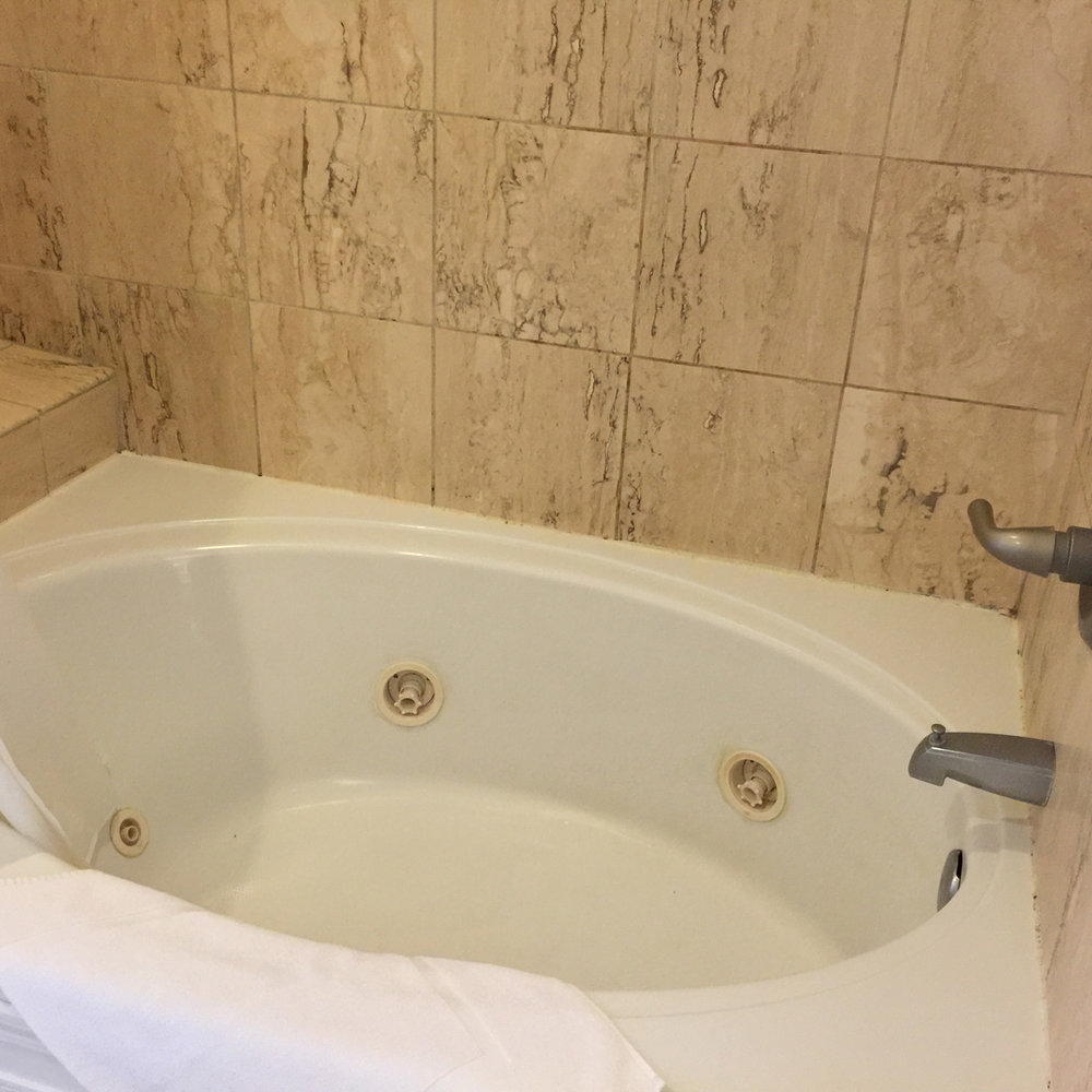 Enjoy a jacuzzi tub in your private bathroom here at The Palms Cliff House Inn