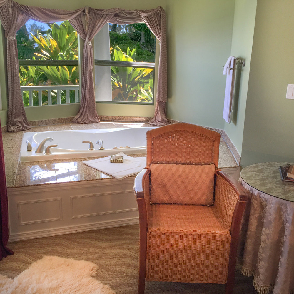 Enjoy sitting in our in-room 2 person jaccuzzi while looking out at the ocean.
