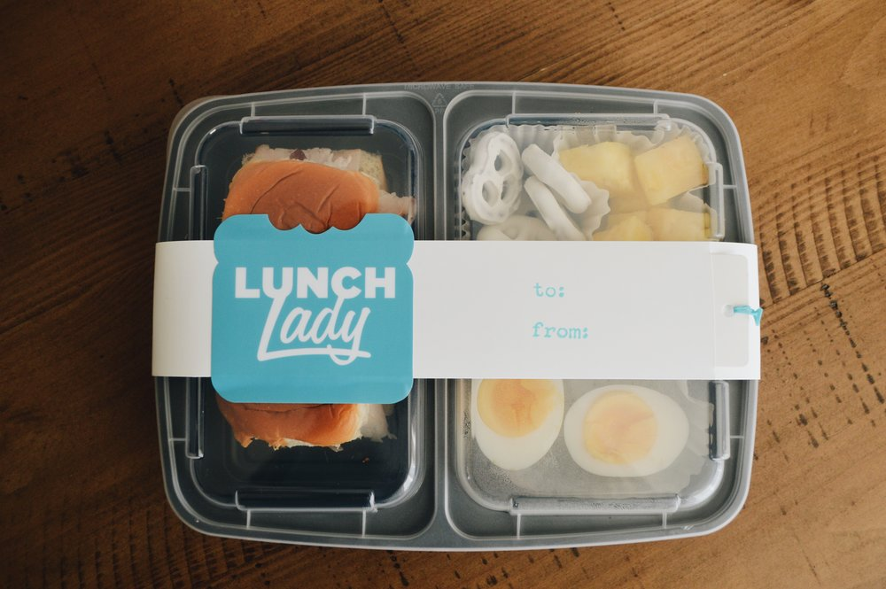 Wednesday's lunch: turkey sliders, yogurt covered pretzels, pineapple a hard boiled egg, and (not pictured here) organic low-fat milk.
