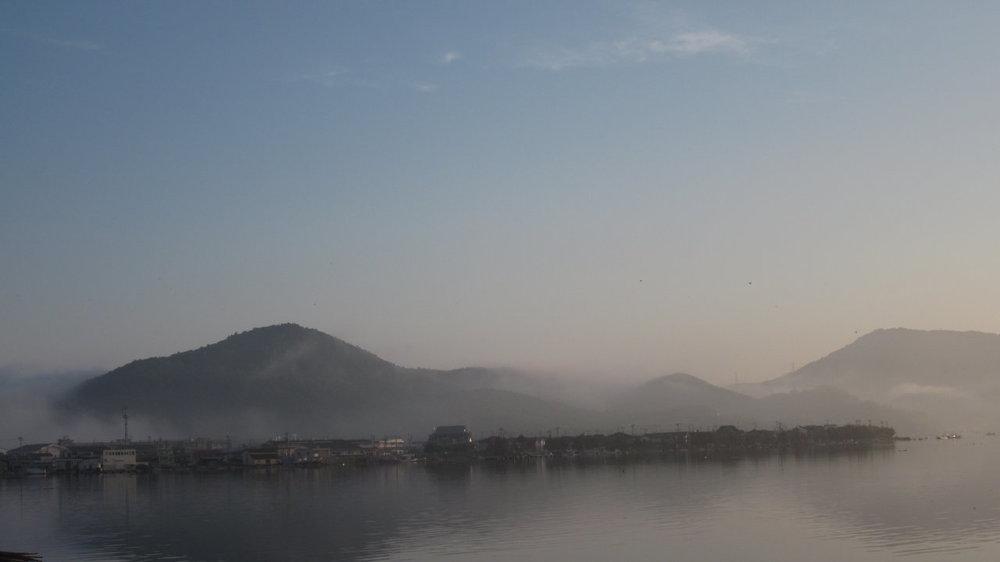 Fog rises over damaged parts of Ishinomaki