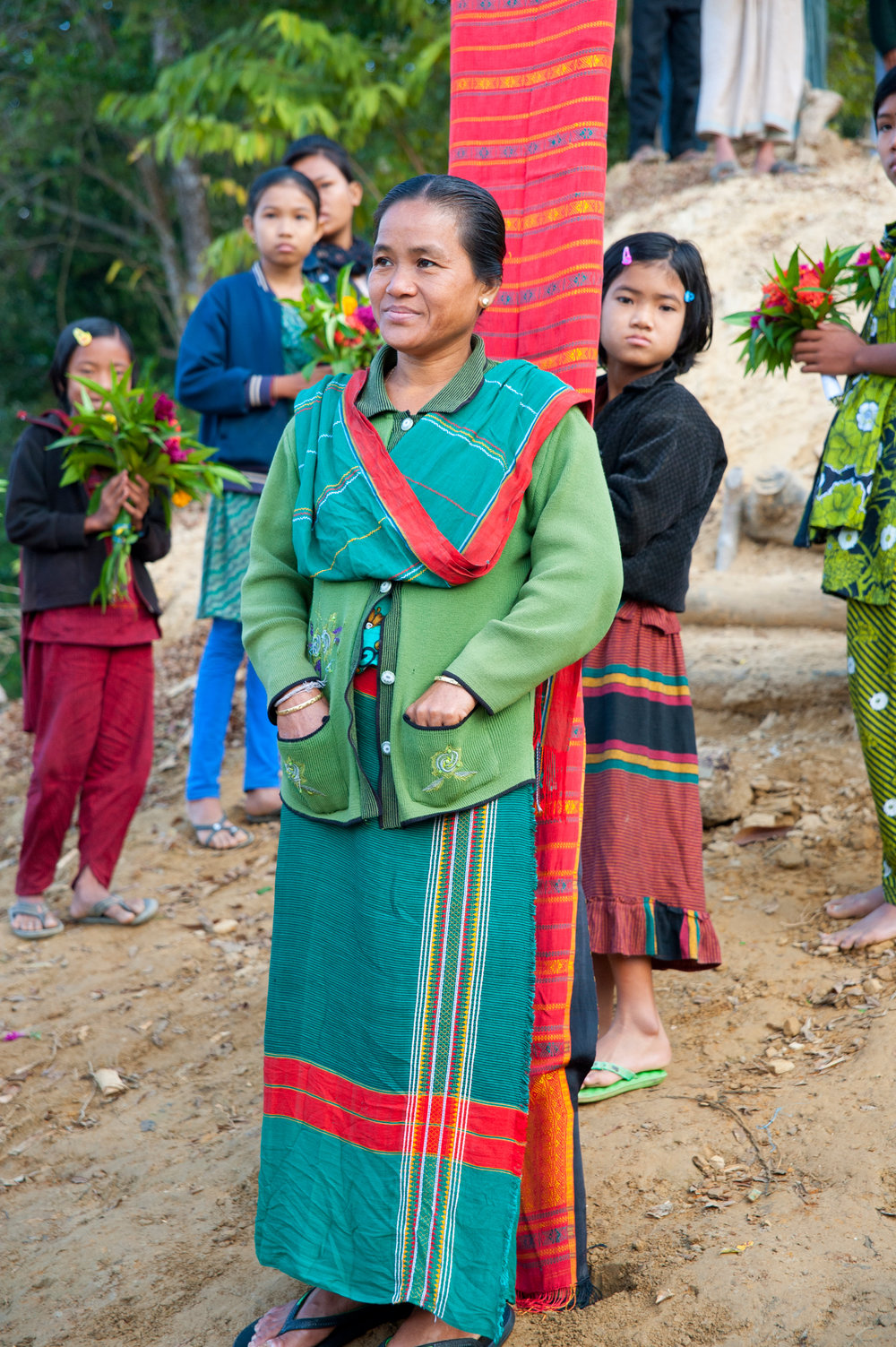 Chakma tribe members greeted us in their best dress on the shores of their village on Lake Kaptai. Photo by Shinobu Suzuki.