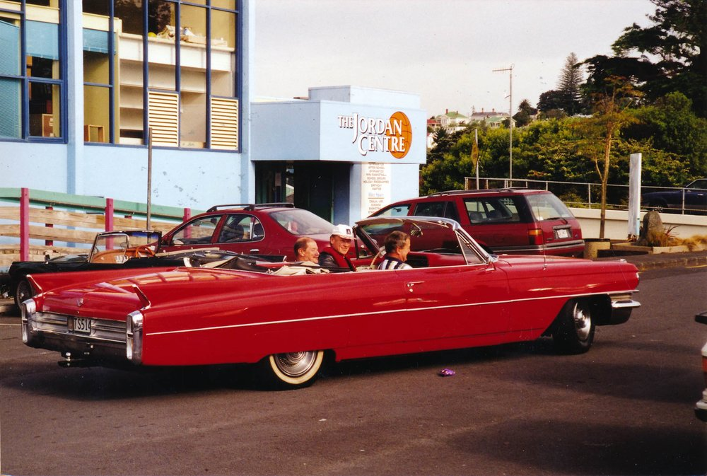 Men going for a sunny cruise outside the Jordan Rec Centre in a flash red cadillac. Photo credit: YMCA Jordan Centre. Circa 90s.